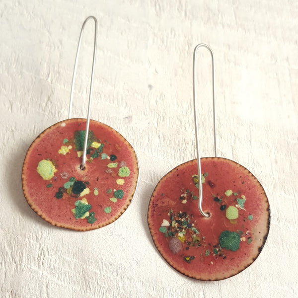 Translucent brown enameled copper earrings with green accents.