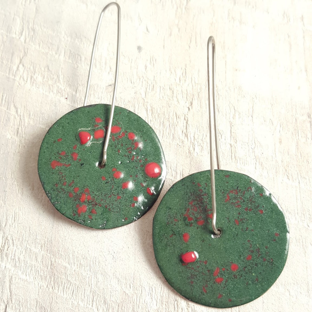 Dark green enameled copper earrings with red dots.