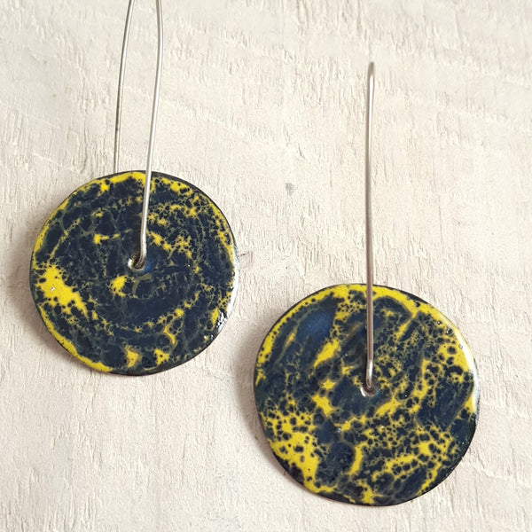 Yellow and blue enameled copper earrings.