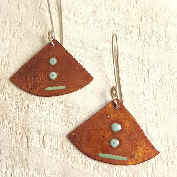 Translucent brown enameled copper earrings with light blue green accents.