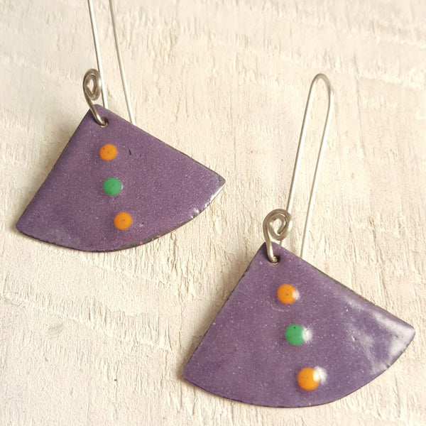 Purple enameled copper earrings with orange and green dots.