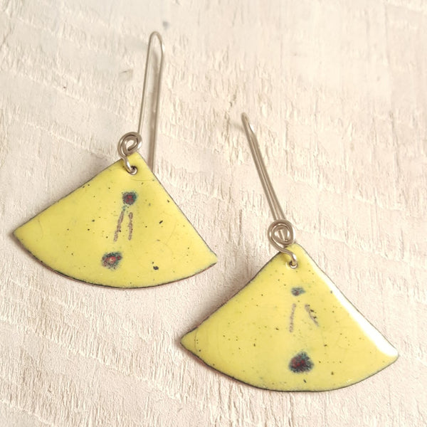 Light yellow enameled copper earring with dot and line accents.