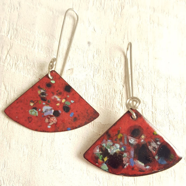 Dark red enameled copper earrings with speckled accents.