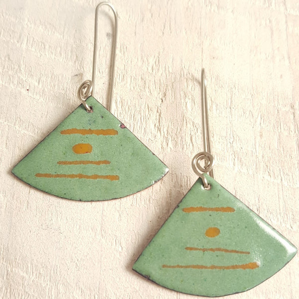 Green enameled copper earring with brown stripes.