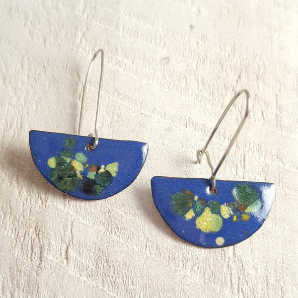 Blue enameled copper earrings with green accents.
