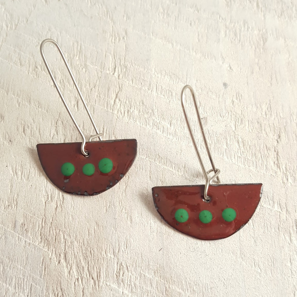 Dark brown enameled copper earrings with green dots.