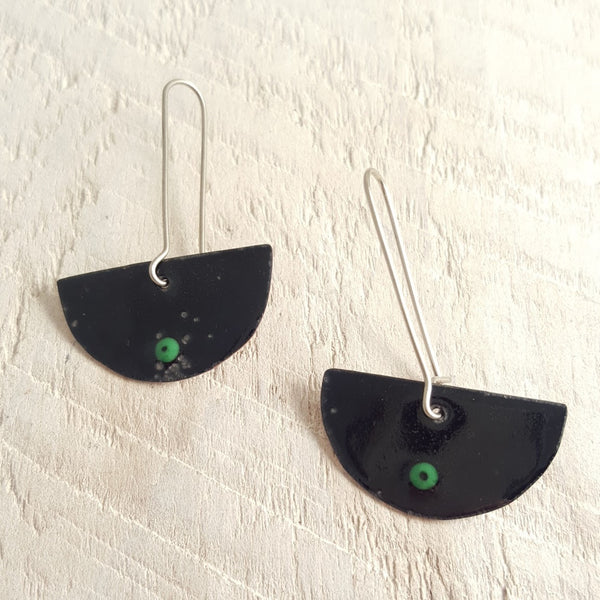 Black enameled copper earrings with green accent.