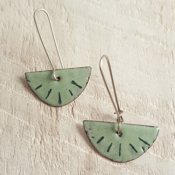 Light green enameled copper earrings with dark green accents.