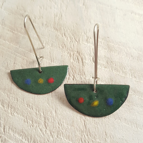Green enameled copper earrings with red, yellow, and blue dots.