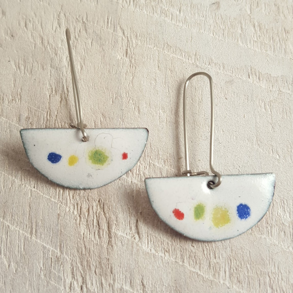 White enameled copper earring with colorful dots.