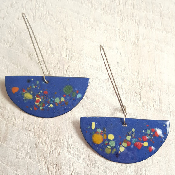 Blue enameled copper earrings with speckled accents.