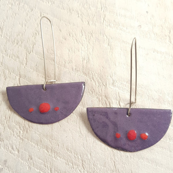 Purple enameled copper earrings with red dots.