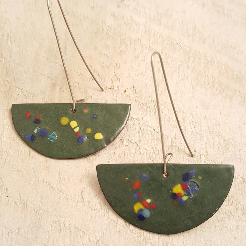 Green enameled copper earrings with speckled accents.