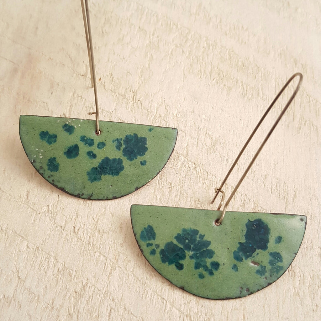 Light green enameled copper earrings with blue accents.