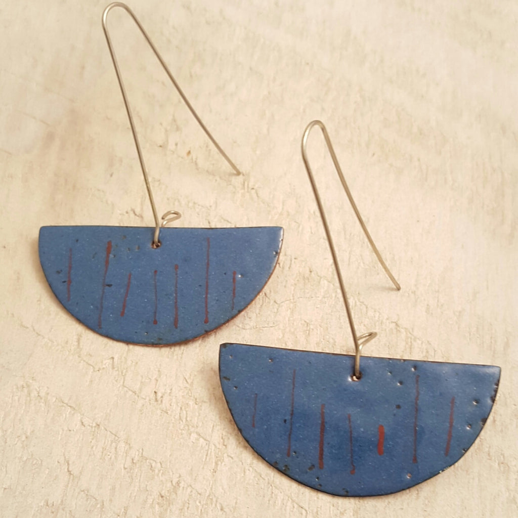 Light blue enameled copper earrings with red accents.