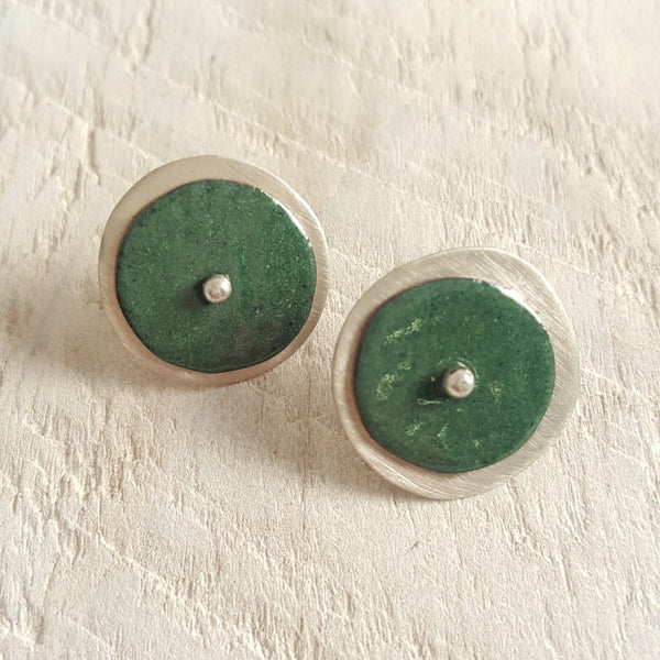 Green enameled copper studs.