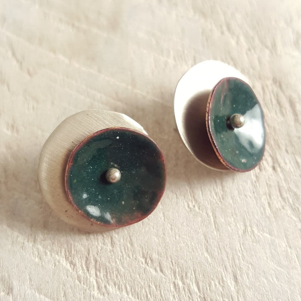 Dark green enameled copper studs.