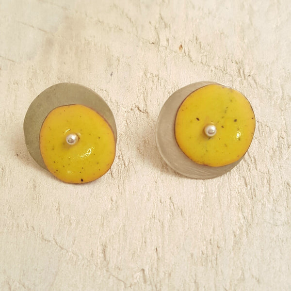 Yellow enameled copper studs.