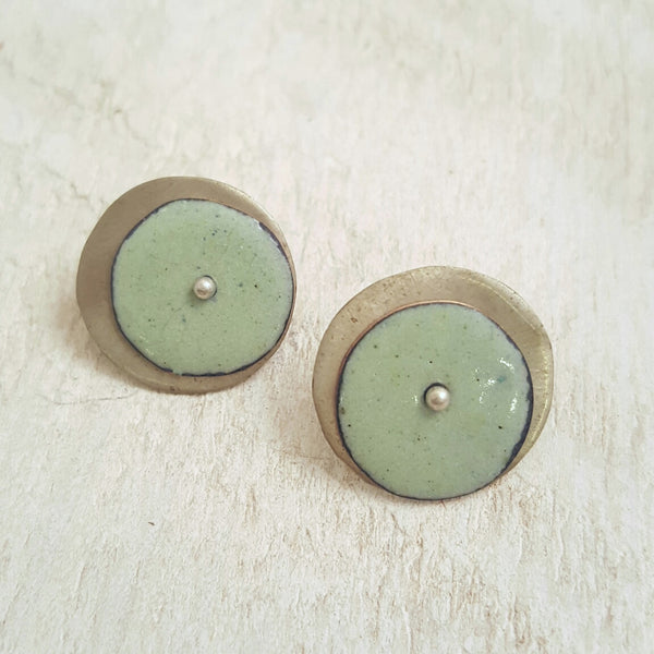 Light green enameled copper studs.