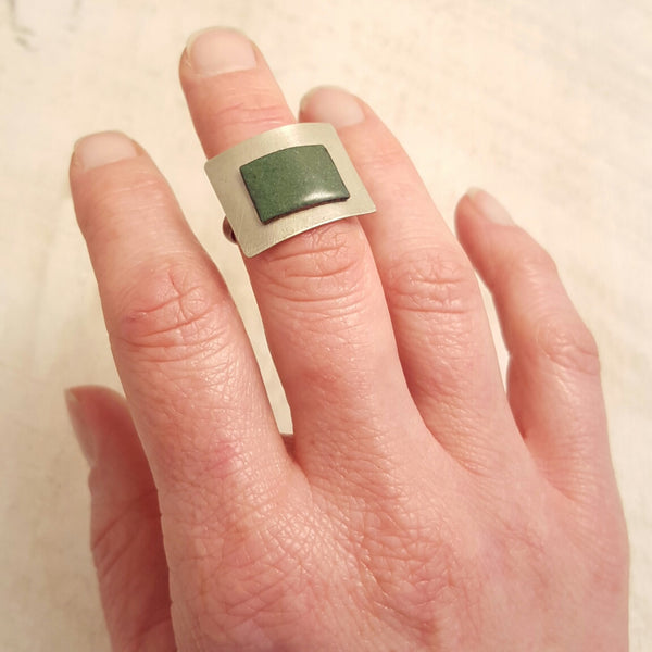 Green enameled copper ring.