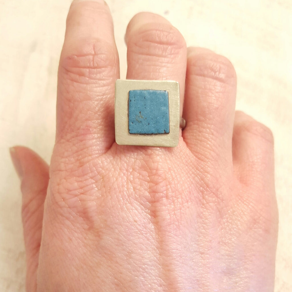 Turquoise blue enameled copper ring.