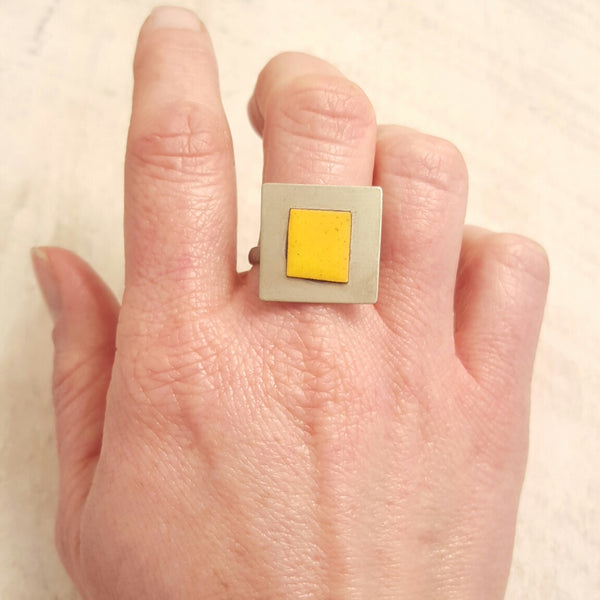 Yellow enameled copper ring.