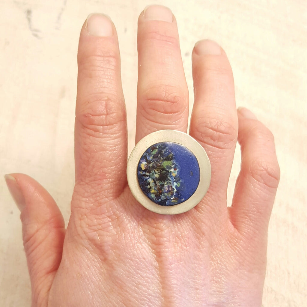 Blue enameled copper ring with speckled accents.