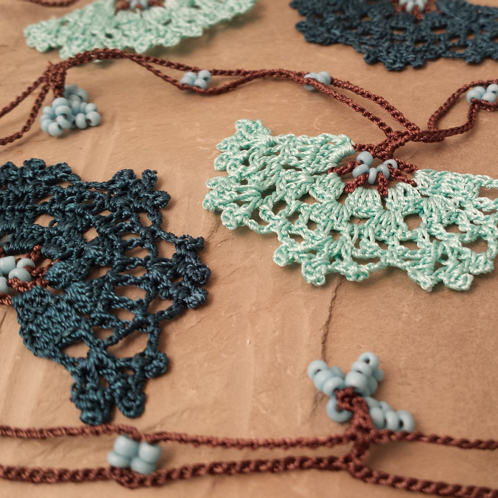 Aqua and teal flowers with brown string.
