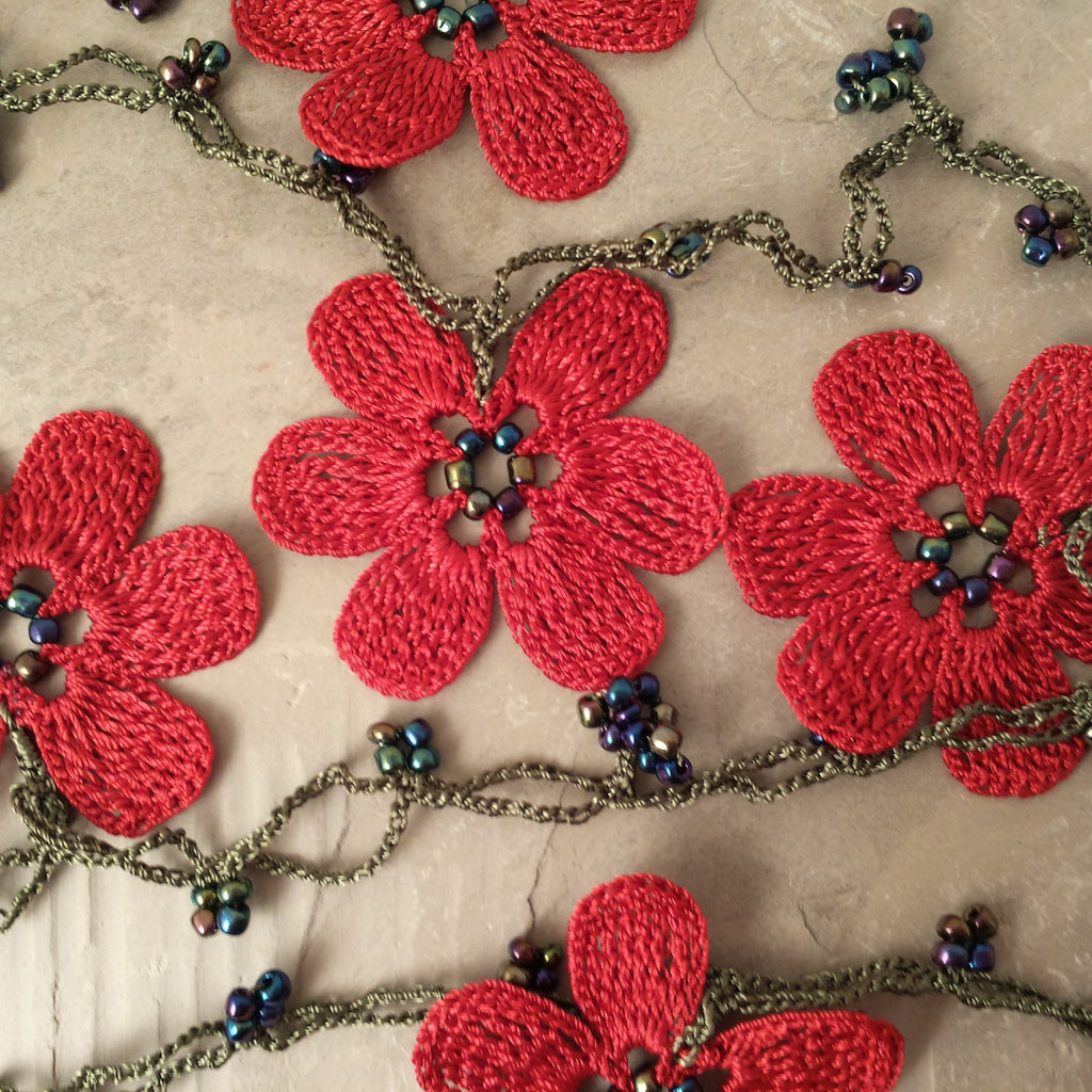 Red flowers with green string.