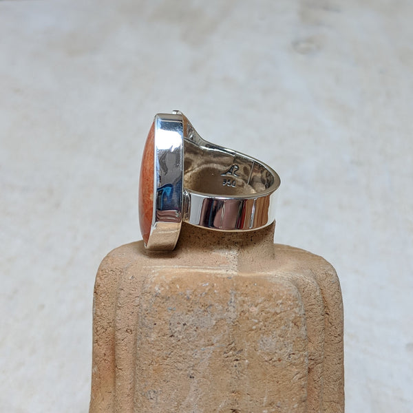 Inside of ring with artists stamp and sterling marker.