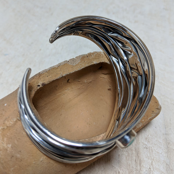 Inside of cuff with artists stamp and sterling marker.