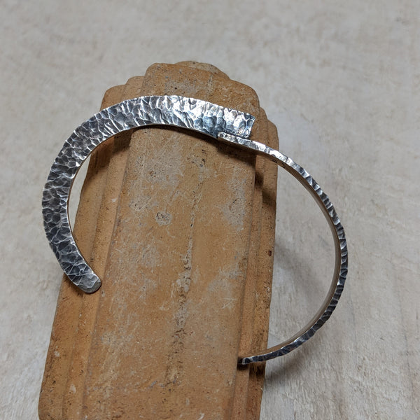 Side view of wrought silver cuff