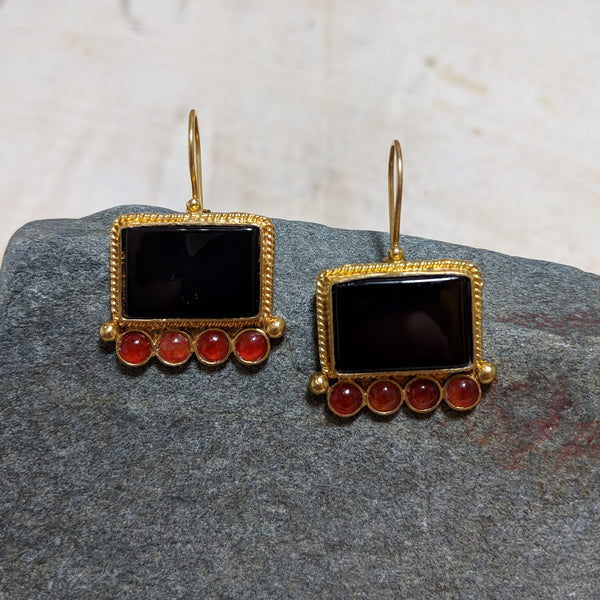 Picture Frame earrings from view in black and red