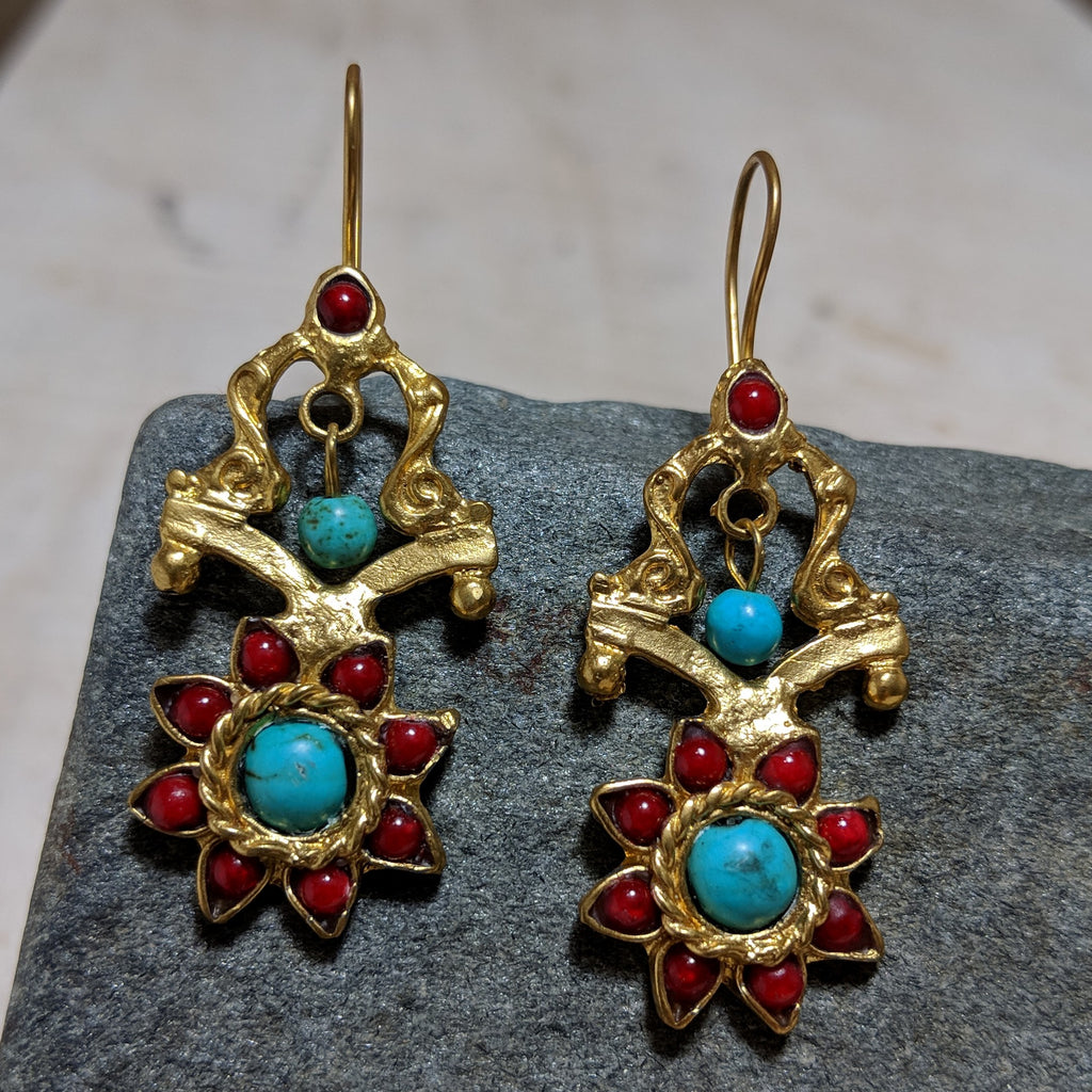 sun fortress earrings in turquoise and red stone