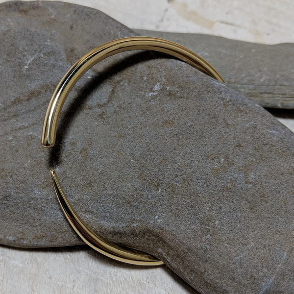 gold tusk bangle angled view