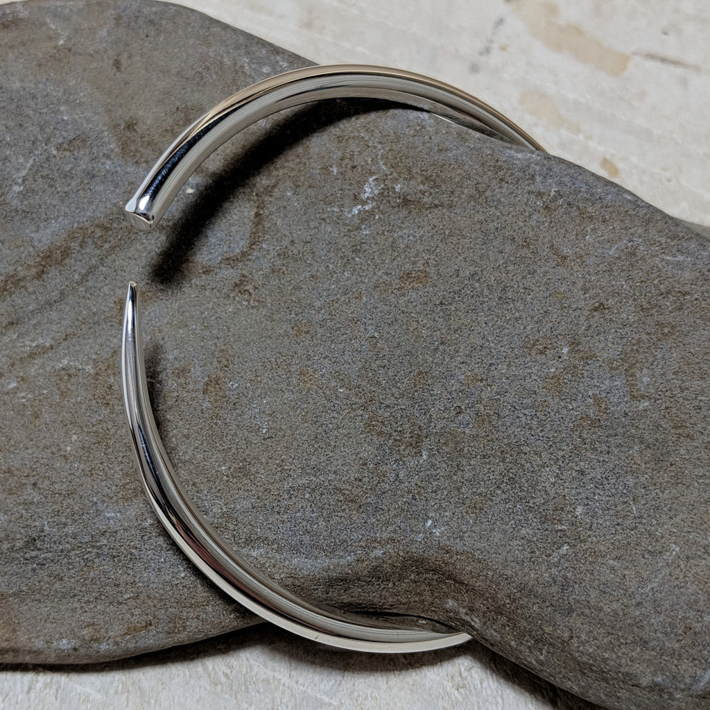 silver tusk bangle angled view