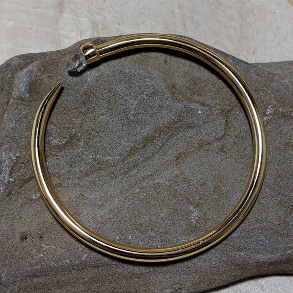 gold tusk bangle side view with quartz