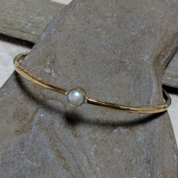 angled view of aviva bracelet with pearl
