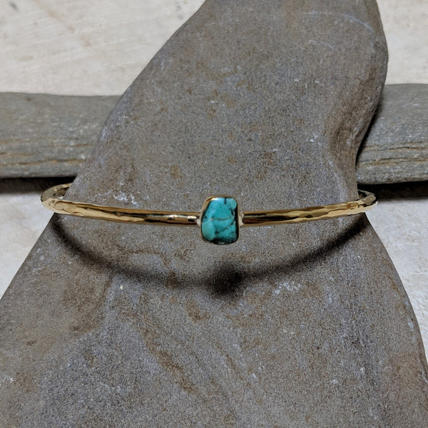 angled view of aviva bracelet with turquoise