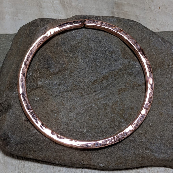 side view of hammered copper bangle