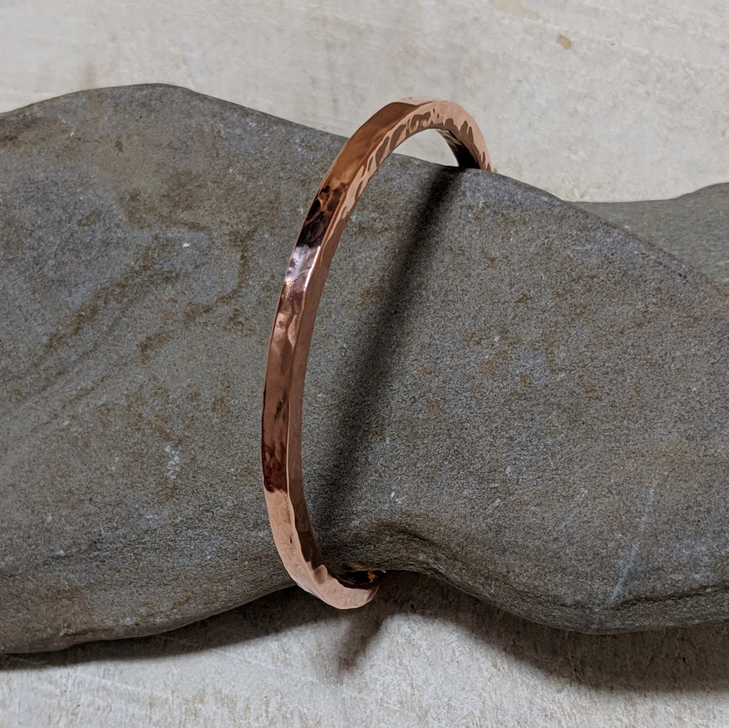 Hammered copper bangle angled view