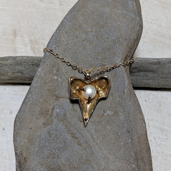 back of shark tooth necklace close up with pearl