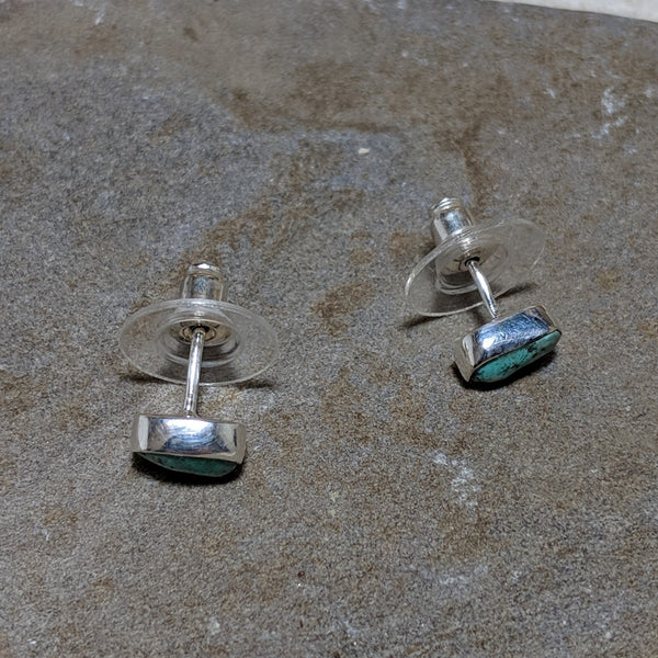 side view of turquoise rocha studs in silver