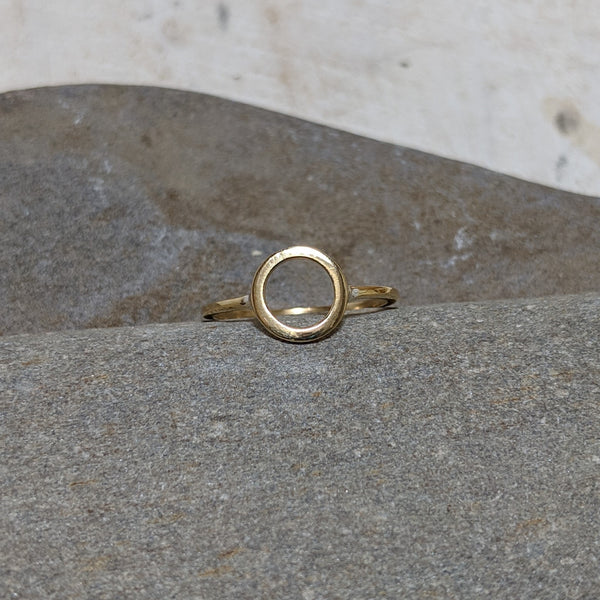 front view of gold open circle ring