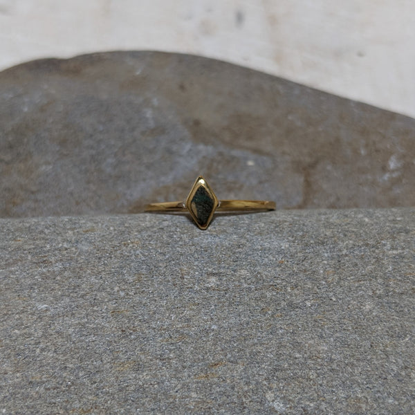 front of gold diamond ring