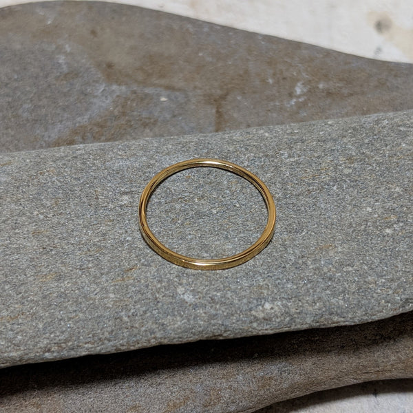 side view of quinn plain stacking ring in gold color