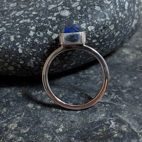 side view of faceted lapis ring