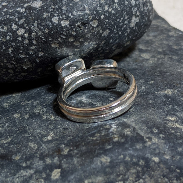 back of faceted rings stacked