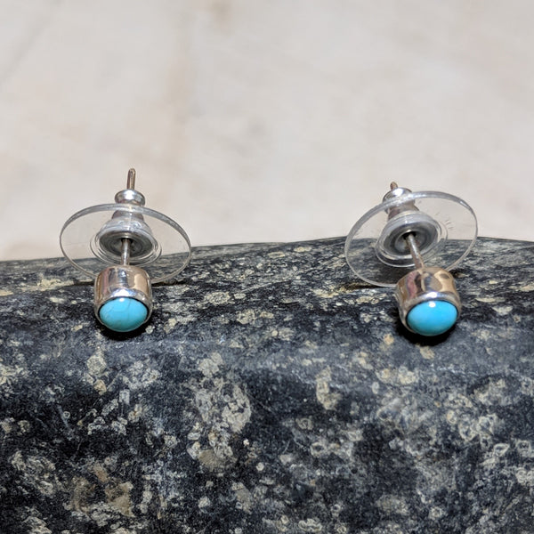 side view of tiny circle studs in turquoise