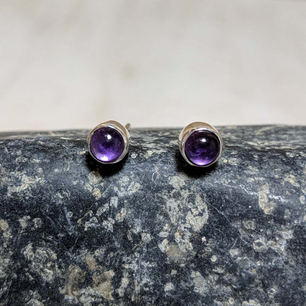 Tiny circle studs in amethyst